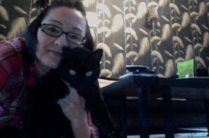 Cat sitter holding a cat